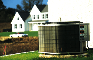 Residential air conditioner on the grass