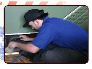 Guy fixing an air duct