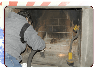 Man cleaning a chimney