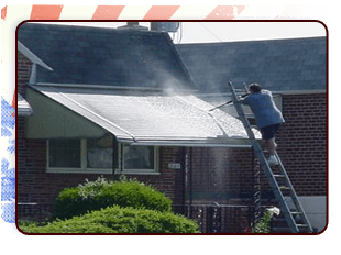 Guy Power washing thr house roof