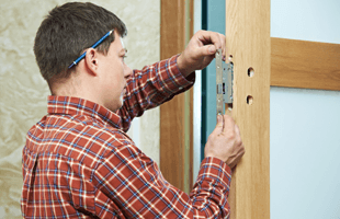 Man Making Key For Door