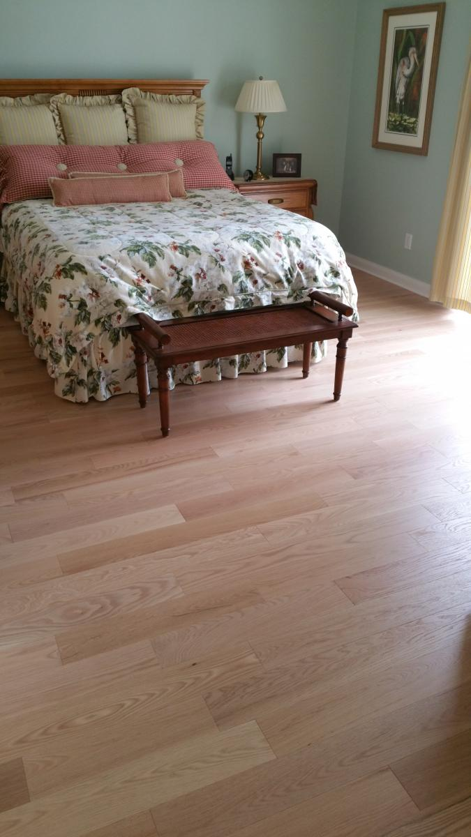 pale tan imitation hardwood laminate flooring in bedroom