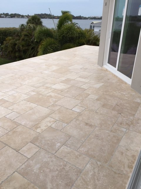 mixed sized tiling for exterior patio, light browns and tans