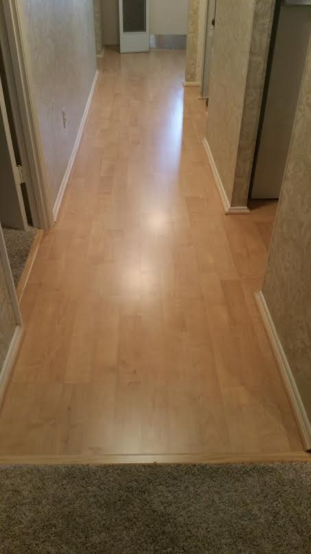 pale tan imitation hardwood laminate flooring in hallway