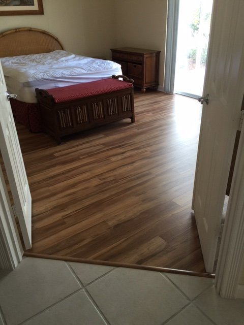 imitation hardwood in bedroom, installed at an angle to the doorway