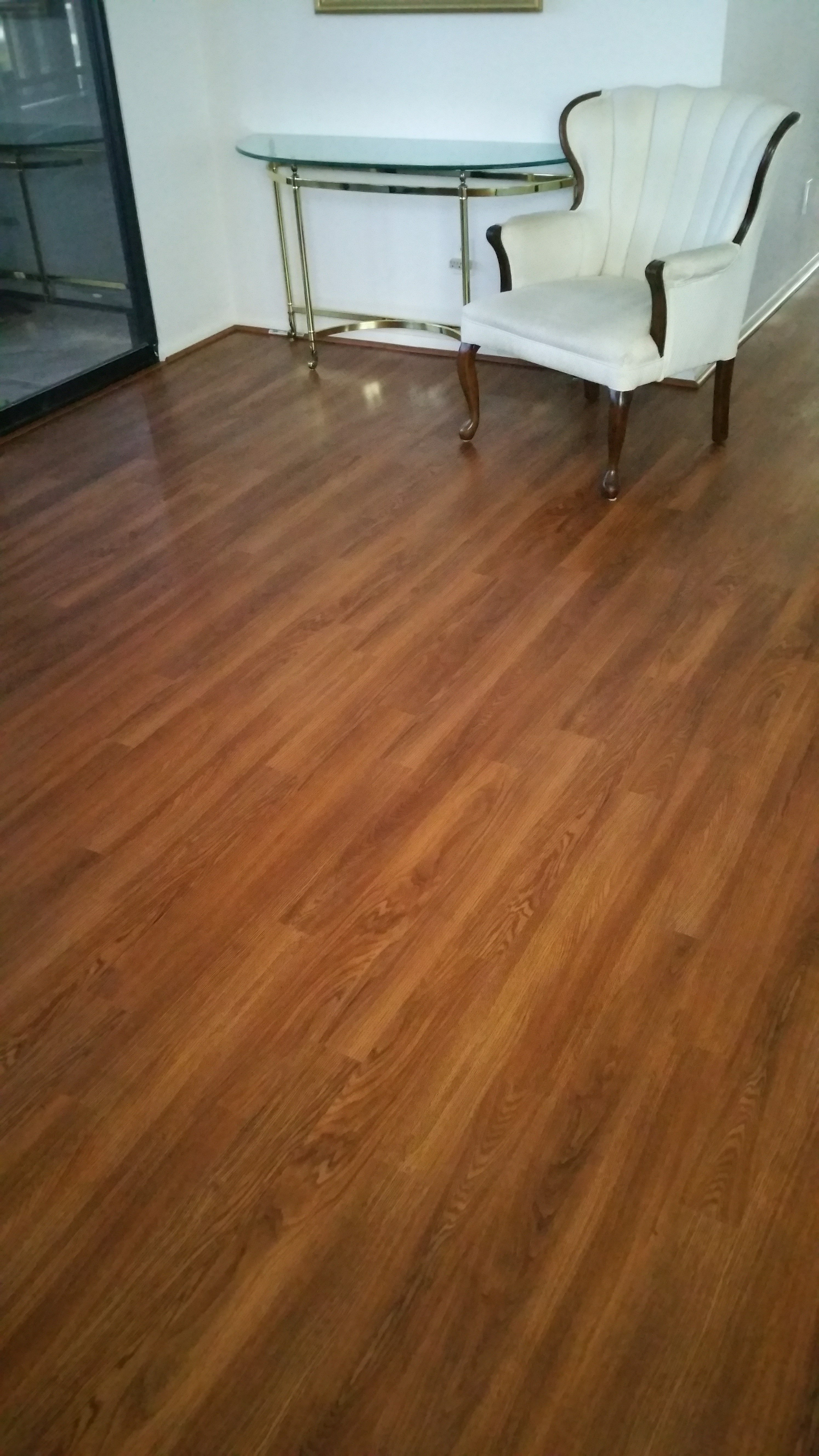 deep oak stained hardwood flooring with white, wooden legged upholstered furniture