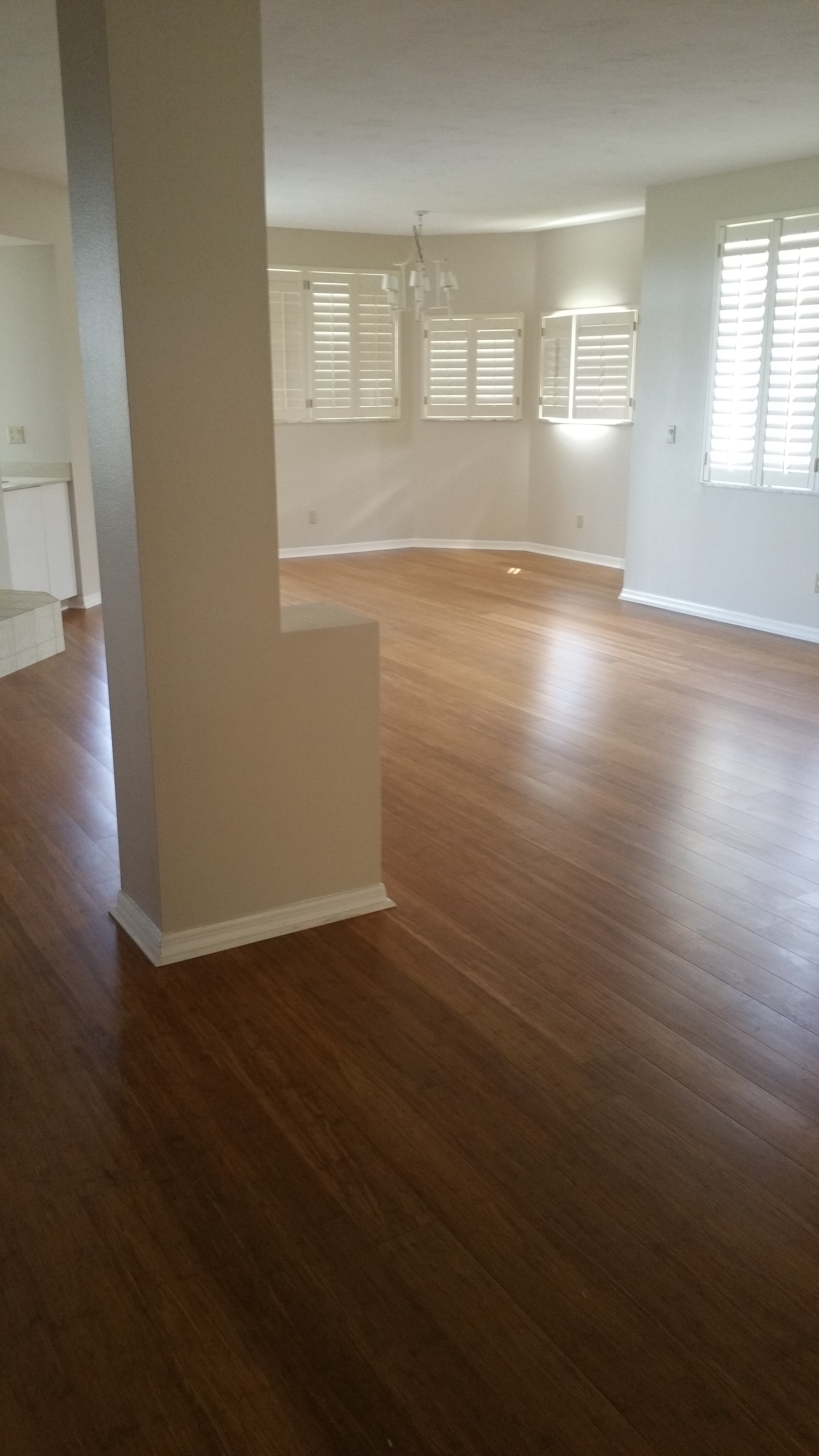 Hardwood Flooring in an empty finished basement