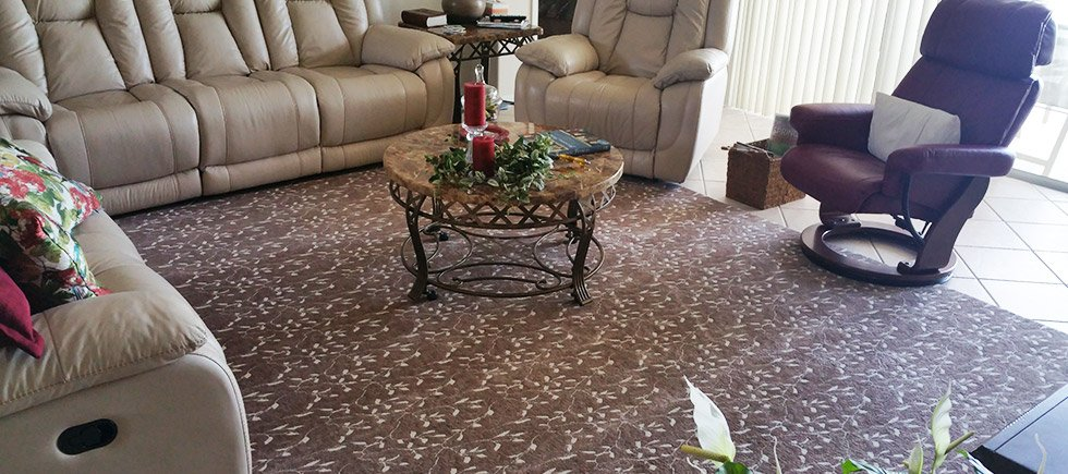 partial installed flat carpet with a brown and tan grain or prairie pattern