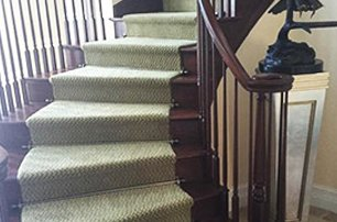 Rod-secured carpet with on exposed wood stair