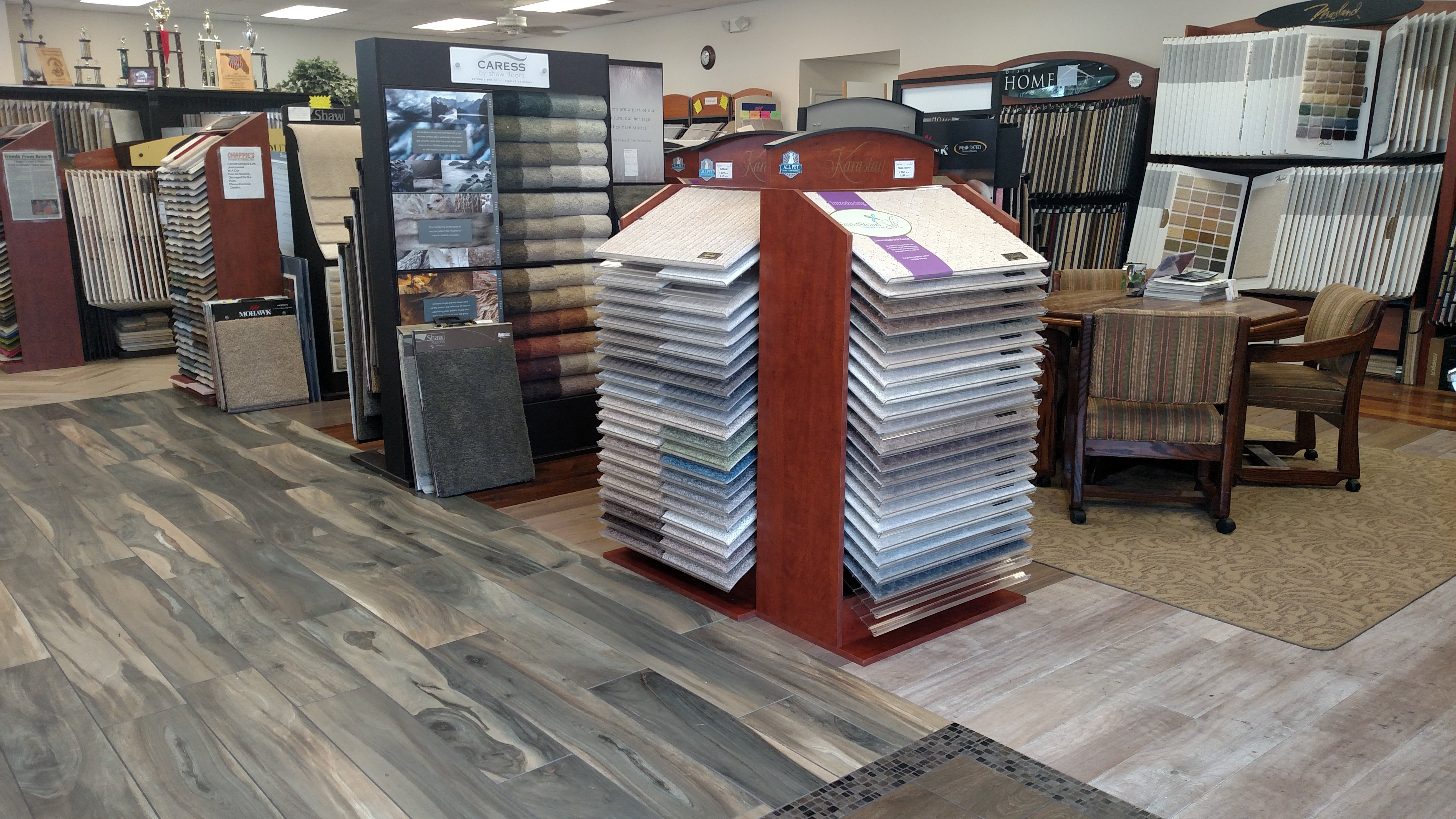 Chappies carpet floors inc flooring sarasota fl interior of show room panel display with a variety of carpet samples doublecrazyfo Gallery