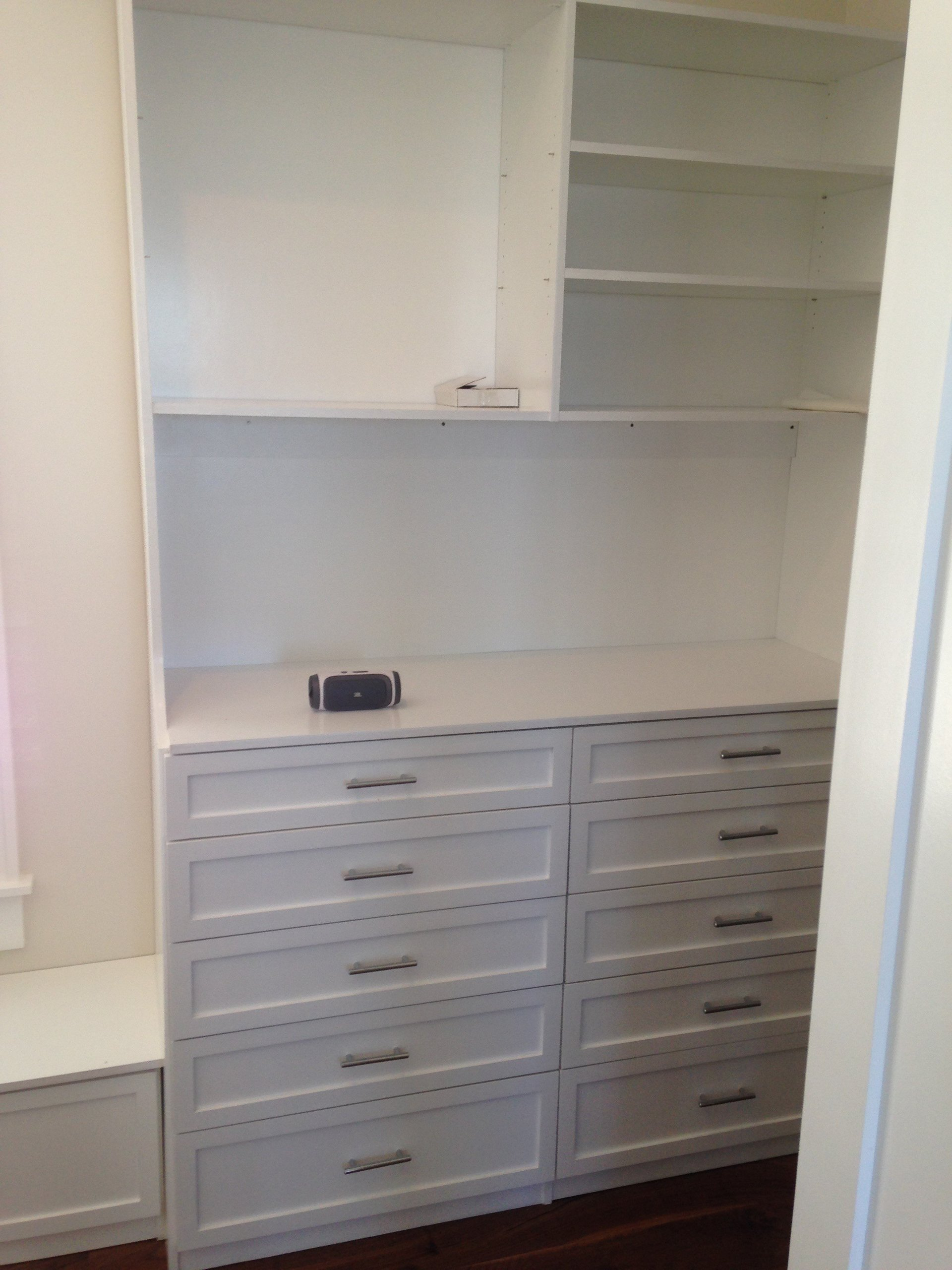artful custom inc house kitchens brendan features bath donovan steam cabinet conceals unit island also show mcbournie furniture vanity shower closet master a co tropical this living built gary suite by