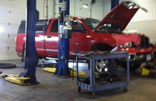 Mechanics   garage   automobile   hood  engine   checking   inspecting   inspection