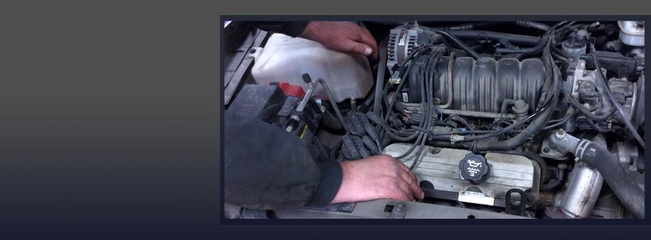 Hands of mechanic working in auto repair shop