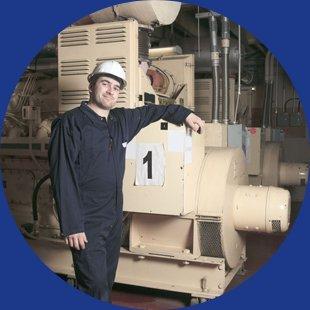 Engineer standing on industrial machine