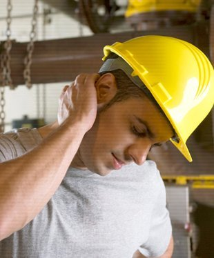 Construction worker rubbing his neck