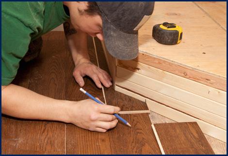 Man measuring wood floor