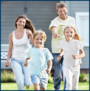 Happy family running on lawn