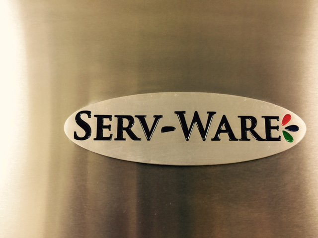 Close-up of Serv-Ware logo on refrigerator door