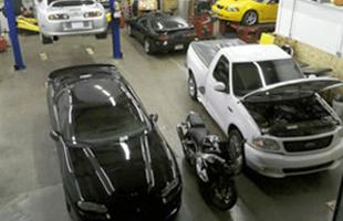 Cars on automotive shop