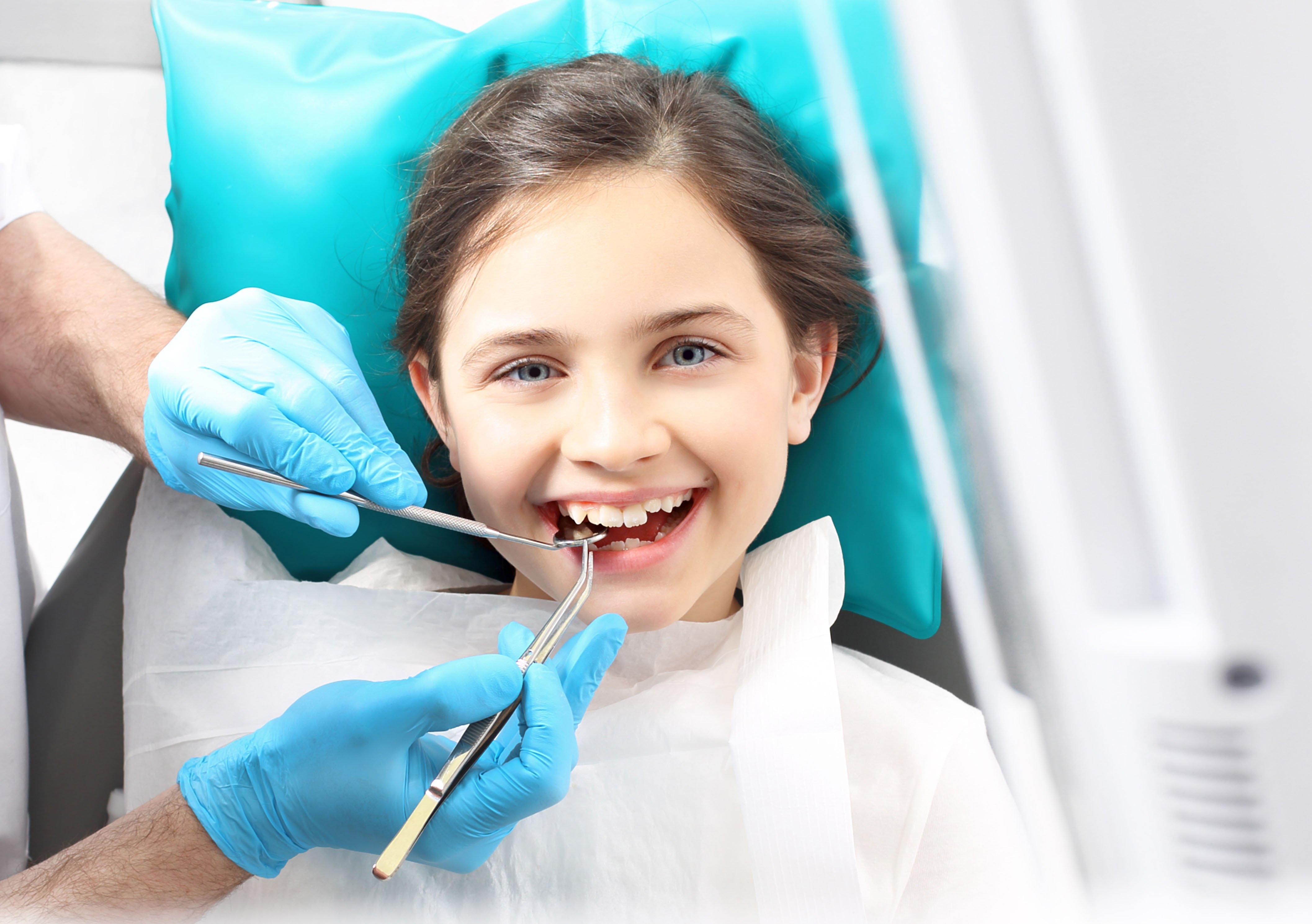 Kid at dental clinic