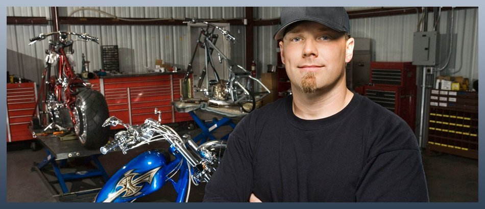 Man with motorcycles in a garage