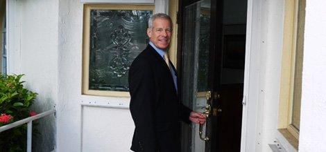 Robert Trachman entering the office
