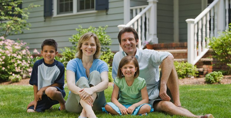 Family infront of house