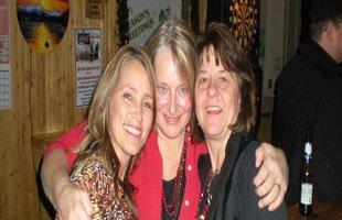 Women smiling inside the bar