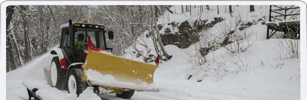 Snow plough clearing path in winter storm