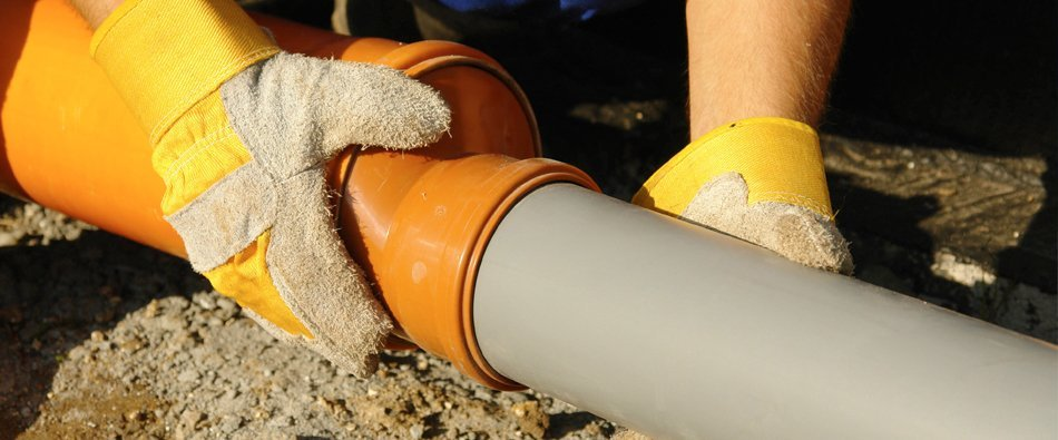 Man installing pipe line