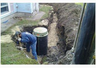 Male excavator digging