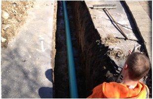 Men working on a pipe underground