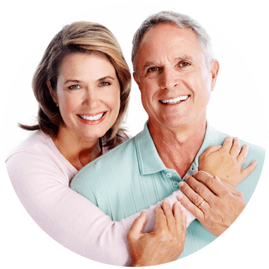 senior citizen, woman hugging man from behind,  couple smiling at camera
