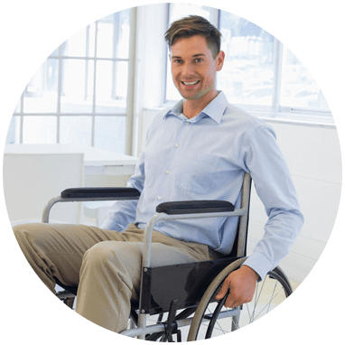 young man smiling at camera in wheelchair
