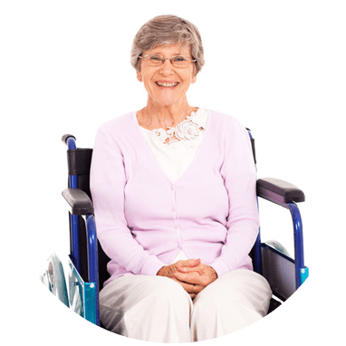 Elderly woman smiling at camera in wheelchair