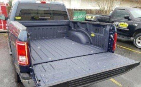Floor of Utility Van Sprayed in Line-X Premium