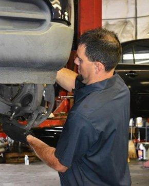 Tri State Auto Service staff repairing the car