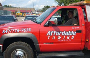 man sitting in Affordable towing truck