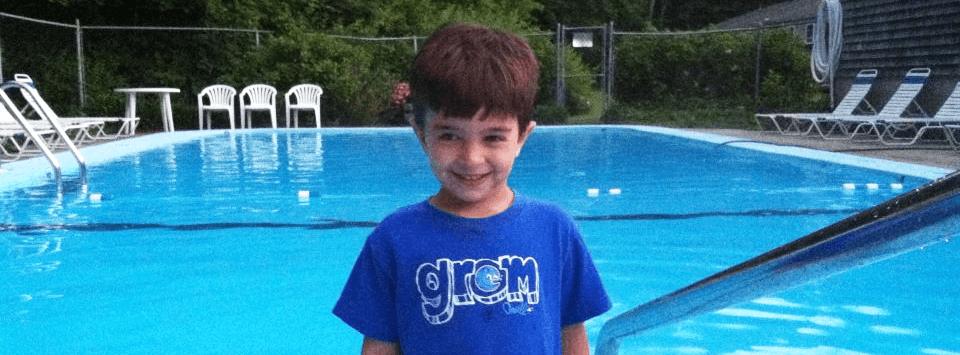 Kid beside swimming pool