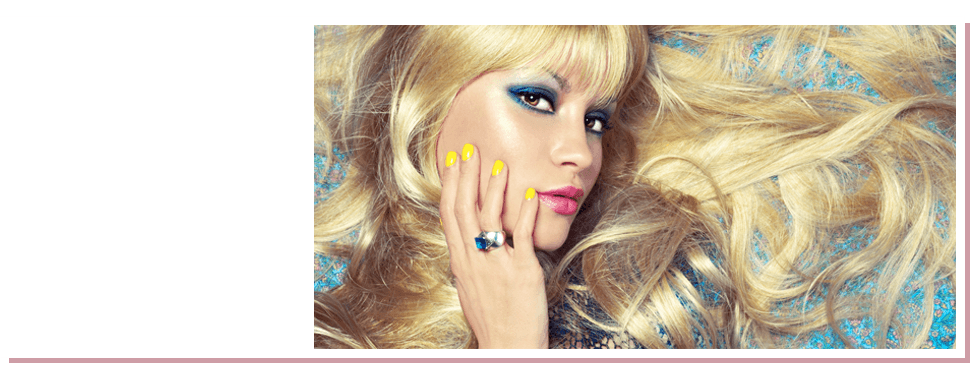 Woman with blonde hair and yellow nail polish