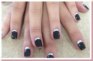 Woman with black and white nail polish
