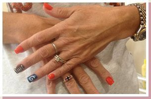 Woman with orange nail polish
