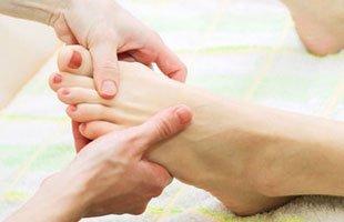 Massaging foot injury