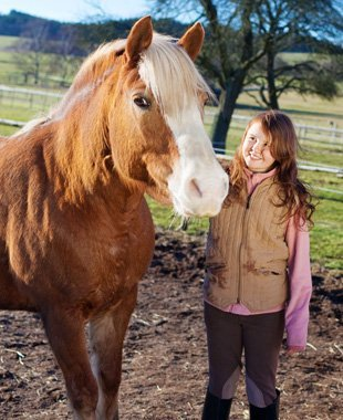 Kid with her horse