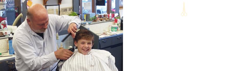 Kid enjoying a hairtcut