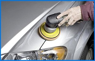 A liquid cleaner is applied to the car finish to remove any grease