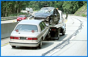 Wrecked cars being towed