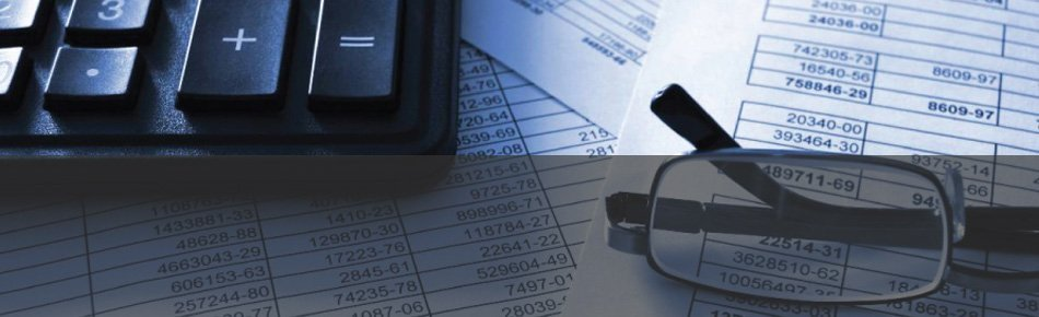 Calculator and eye glasses ready for tax preparation