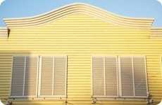 Yellow siding with window
