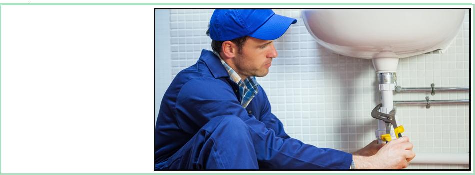 Attractive focused plumber repairing sink in public bathroom